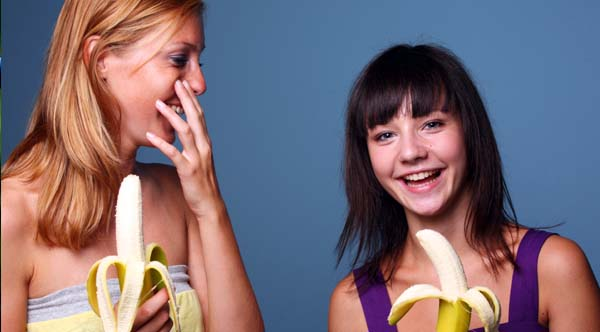 happy-woman-eating-bananas